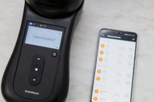 Натисніть центральну кнопку ще раз, та передайте результати виміру на ваш смартфон (iOS або Android) з встановленим додатком GrainSense.
